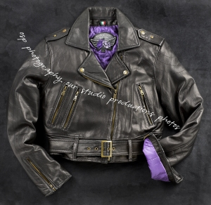 Leather jacket photographed on black mottled background.